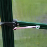 A hanging plant hook (optional accessory) is a convenient place to hook a spring or rubber band to prevent winds from lifting the door latch.